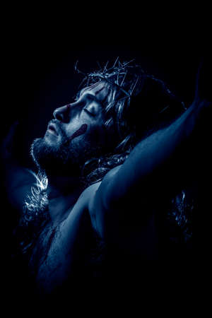 Foto de Jesus Christ crucified with crown of thorns during the passion - Imagen libre de derechos