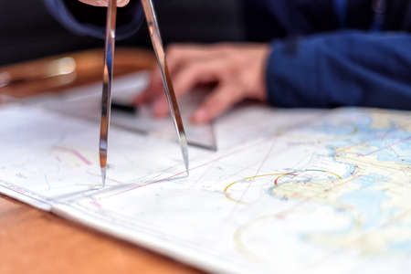 Photo for navigation with sea charts in the chart room on a sailing yacht - Royalty Free Image