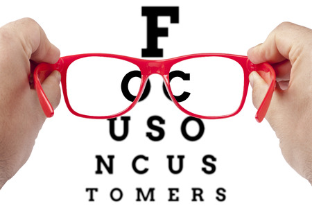 Photo for Red spectacles focusing on text focus on customers arranged as eye chart test - Royalty Free Image