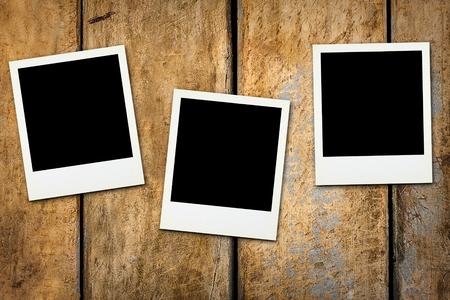 Photo pour Three blank polaroids on wooden surface background - image libre de droit