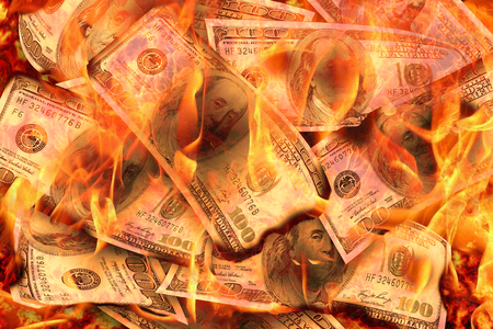 Foto de Dollars Banknotes or bills of United States of America dollars burning in flame concept of crisis, loss, recession or failure - Imagen libre de derechos
