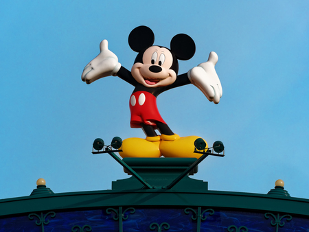 Photo for Paris, France - April 2019: Statue of mickey mouse against light blue sky  at disneyland funfair - Royalty Free Image