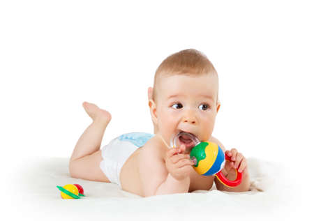 Foto de Baby holding a toy isolated on white background - Imagen libre de derechos