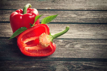 Photo for Fresh sweet red pepper on old wooden background - Royalty Free Image
