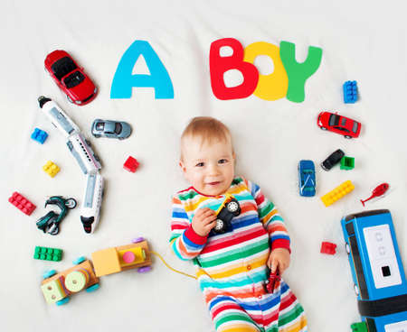 Photo pour Baby boy lying on soft blanket with letters above - image libre de droit