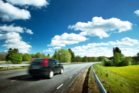 Photo pour Car on asphalt road in beautiful spring day at countryside - image libre de droit