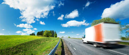 Photo pour asphalt road on dandelion field with a small truck. van moving on sunny day - image libre de droit