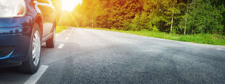 Photo for Car on asphalt road in summer - Royalty Free Image