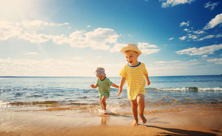Photo for Boy and girl playing on the beach - Royalty Free Image