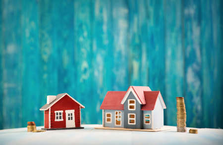 Photo for Red house on wooden background with banknotes - Royalty Free Image