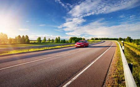 Photo pour car moving on sunny evening - image libre de droit