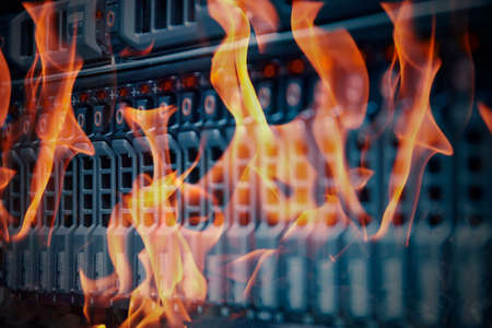 Foto de Disaster in data center room server and storage on fire burning - Imagen libre de derechos