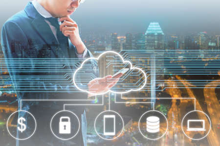 Photo pour Double exposure of professional businessman connected Cloud technology with internet and wireless network with his smart phone and city of business background in business trading and technology concept - image libre de droit