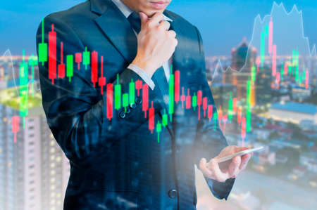 Foto de Double exposure of professional businessman analyse stock candle stick graph of stocks market on digital touch screen in business stock trading concept - Imagen libre de derechos