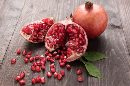 Photo pour Ripe pomegranate fruit on wooden vintage table. - image libre de droit