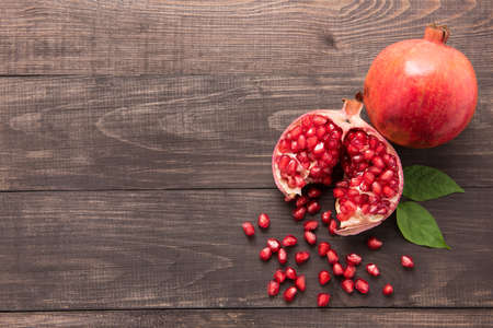 Photo for Ripe pomegranate fruit on wooden vintage background. - Royalty Free Image