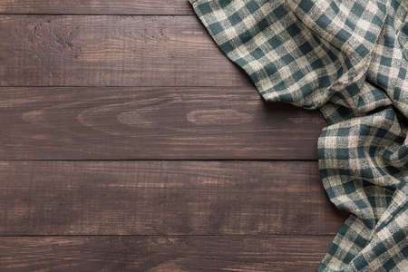 Foto de Napkin on the wooden background. Top view. - Imagen libre de derechos