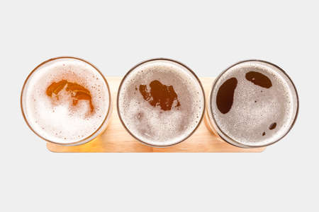 Foto de Assortment of beer glasses isolated on white background. Top view. Clipping Path included isolated on white background. - Imagen libre de derechos