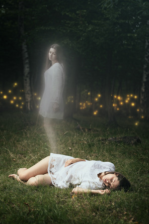 Photo for Soul of a dead girl is leaving her body. Forest spirits are waiting  - Royalty Free Image