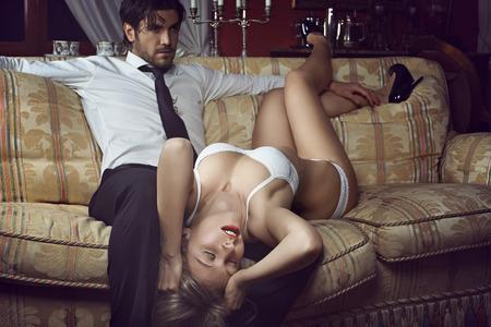 Photo pour Beautiful woman in lingerie with elegant man. Love and fashion concept - image libre de droit
