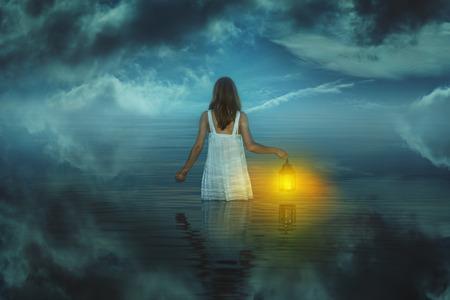 Foto de Woman in strange and surreal waters . Weird and fantasy - Imagen libre de derechos