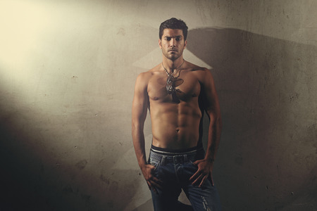 Foto de Handsome man with muscular body posing shirtless . Urban and fashion style - Imagen libre de derechos