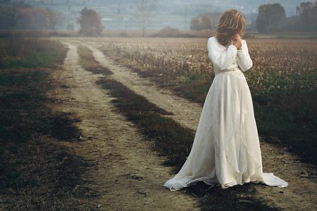 Foto de Beautiful woman with bride dress . Sadness and melancholy - Imagen libre de derechos