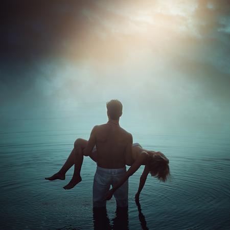 Foto de Man in ethereal water with dead lover. Dark romance  - Imagen libre de derechos