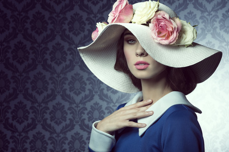 Foto für elegant pretty woman in blue dress with a spring white hat , with pink and white roses over . - Lizenzfreies Bild