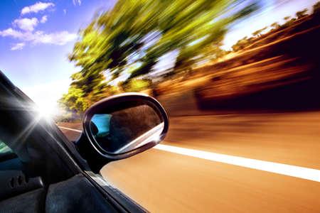 Photo pour Car travel concept. Rearview and non urban road - image libre de droit