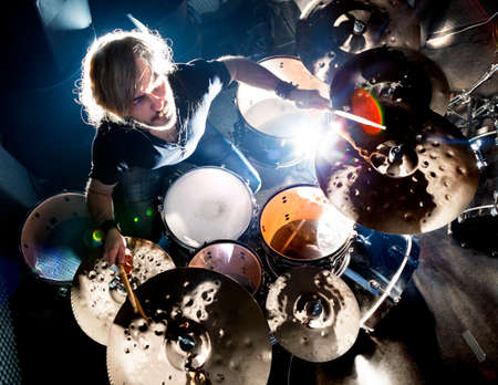 Photo pour Man playing the drum.Live music background concept.Drummer and rock music - image libre de droit