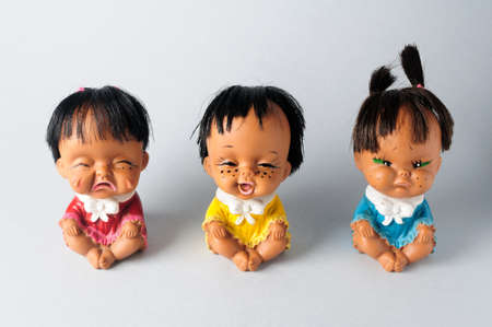 Trio of dolls with different emotions.