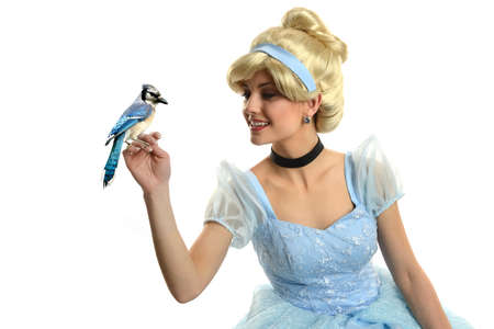 Photo pour Cinderella holding a bird isolated on a white background - image libre de droit