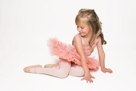 Young ballet dancer wearing an apricot tutu