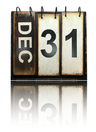 Photo for December 31 with vintage calendar and reflection on white background - Royalty Free Image