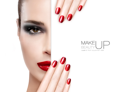 Photo for Beauty Makeup and Nai Art Concept. Beautiful fashion model woman with smoky eye makeup, foundation on a unblemished skin and trendy red lipstick to match her manicured nails, half face with a white card template. High fashion portrait isolated on white - Royalty Free Image
