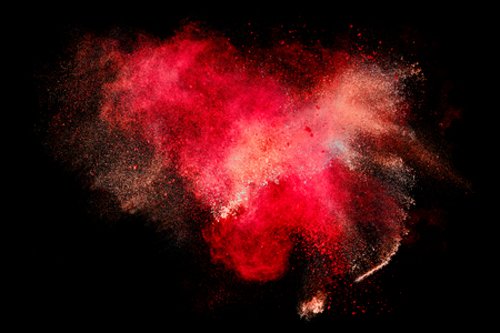Photo for Colorful dust particle explosion resembling blood or a pyrotechnic effect over black. Abstract background. Closeup of a color explosion isolated on black - Royalty Free Image