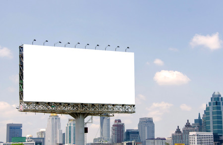 Photo pour large blank billboard on road with city view background - image libre de droit