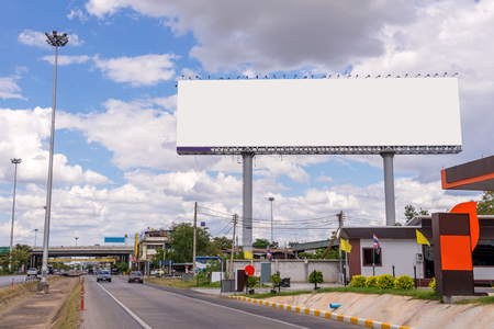 Foto de large blank billboard on road with city view background. - Imagen libre de derechos