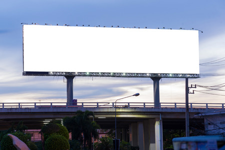 Foto de Blank billboard at twilight time ready for new advertisement. - Imagen libre de derechos