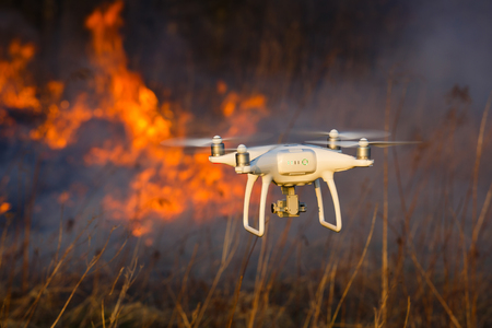 Photo for The drone flies against the background of a spring forest fire - Royalty Free Image