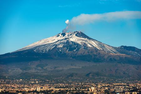 Foto de The mount Etna Volcano with smoke and Silvestri craters in the Catania city, Sicily island, Italy (Sicilia, Italia) Europe - Imagen libre de derechos