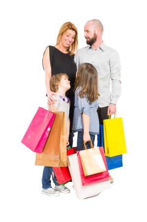 Shopping family of husband, wife and two young daughters