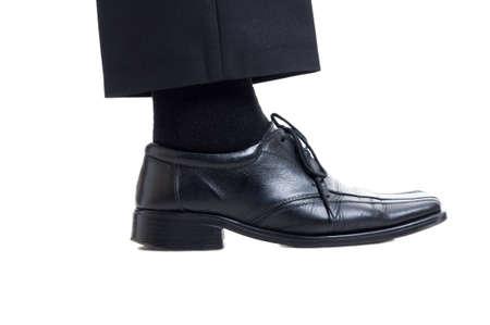 Foto de Classic black suit pants, sock and leather shoe isolated on white background. Business manager foot concept - Imagen libre de derechos