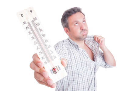 Foto de Sweaty man holding thermometer as summer heat concept isolated on white - Imagen libre de derechos