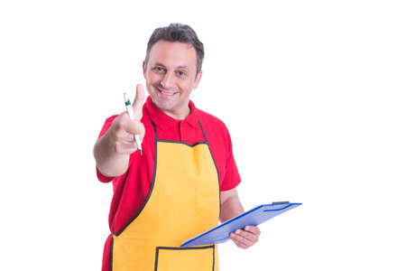 Photo pour Successful supermarket employee rising thumb up and holding clipboard with checklist - image libre de droit