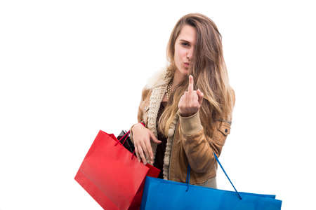 Photo for Rude hipster fashion girl doing obscene gesture while doing shopping - Royalty Free Image