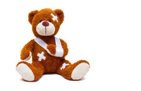 Foto de Injured teddy bear on white background - Imagen libre de derechos