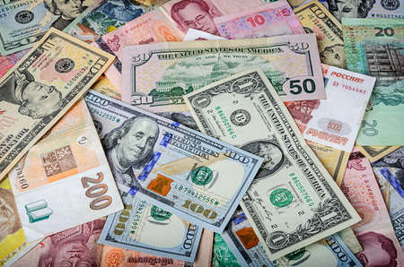 Photo for A collection of various foreign currencies from countries spanning the globe. Many different currencies as colorful background concept global money - Royalty Free Image