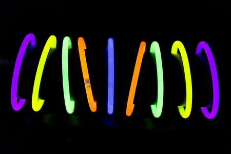Photo for Bracelet jewel made with glow sticks neon light fluorescent on back background. Nightclub cocktail bar atmosphere - Royalty Free Image